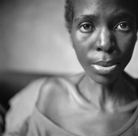 Kristen Ashburn's untitled photograph of Maria Vindi, a former nurse in South Africa now living in Zimbabwe, and ill with HIV/AIDS, for which she cannot afford treatment.